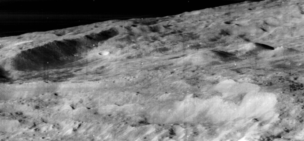 Cyrillus central peaks and southeastern crater wall (to the left) as imaged by the Lunar Orbiter 3.