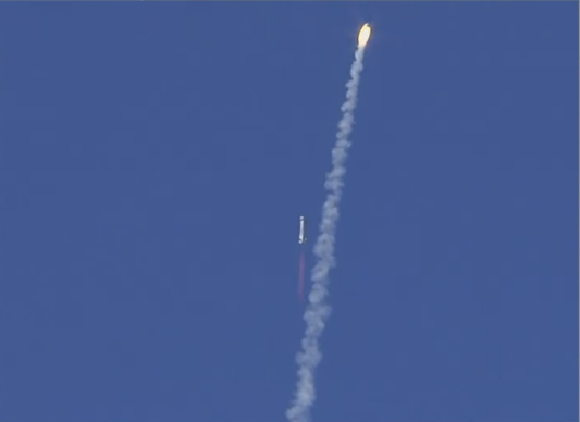 Blue Origin crew capsule blasting away from rocket booster